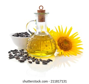 Sunflower oil in bottle with seeds and flower isolated  on white background