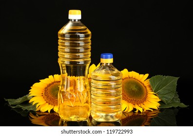 sunflower oil and sunflower isolated on black