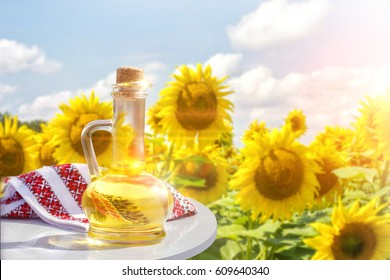 Sunflower oil on the background of sunflowers.