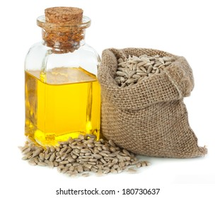 Sunflower oil and sunflower seeds in small sack isolated on white background