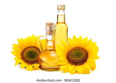 Sunflower oil in vintage glass bottles with two fresh sunflowers isolated on white background