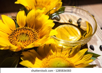 Sunflower oil and yellow flowers with sunshine on background, food ingredient