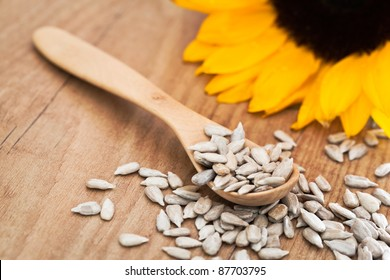 Sunflower seed with a wooden spoon.