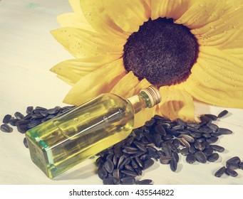sunflower, sunflower seeds and a bottle of sunflower oil