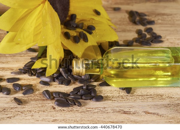 sunflower, sunflower seeds and a bottle of sunflower oil