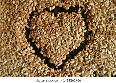 sunflower seeds. heart on the black bsckground.