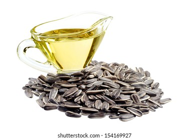 Sunflower seeds and oil isolated on white background