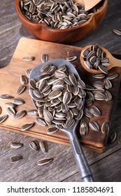 Sunflower Seeds on Wood Background