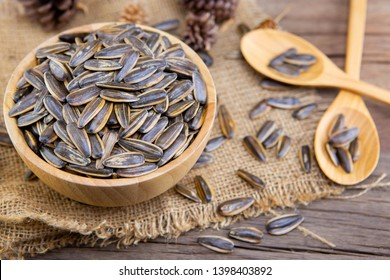 sunflower seeds in wooden bowl with selective focus