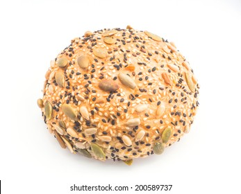 Sunflower and sesame seeds bun on white background