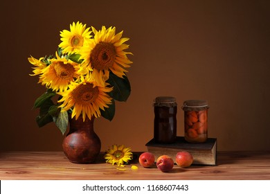 Sunflower In Vase Fruits And Books On The Table