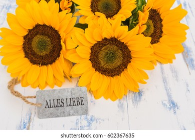 Yellow flowers of a sunflower on a white images stock photos sunflowers bouquet beautiful yellow flowers with german text alles liebe means love greeting mightylinksfo