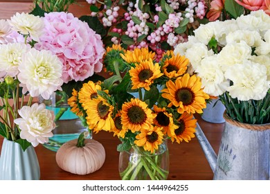 Sunflowers, dahlias, carnations and hydrangeas in flower shop.