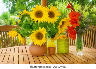 Sunflowers and gladioli on garden table