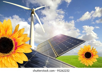 Sunflowers, solar panels and wind turbines in a green field