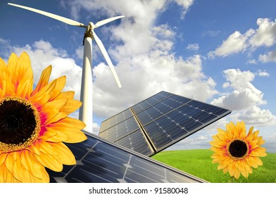 Sunflowers, solar pannels and wind turbines in a green field