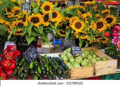 Sunflowers and vegetables for sale at a market in Aix-en-Provence