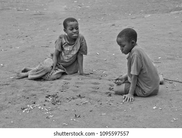 Sunga, Tanga, Tanzania, 2 October 2013: Two kids playing Mancala at their village in the Usambara mountains