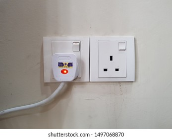 Sungai Buloh, Selangor. Sept 05 2019. Switch socket outlet with plug three pin on the high wall.