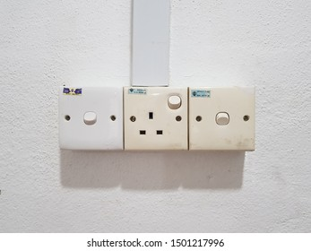 Sungai Buloh, Selangor. Sept 07 2019. Switch socket outlet, plug three pin and on/off switch on the high wall.