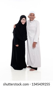 SUNGAI PETANI, MALAYSIA - 21 MARCH 2019:happy elderly couple portraits laughing together isolated on white background.