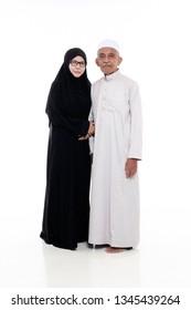 SUNGAI PETANI, MALAYSIA - 21 MARCH 2019:muslim portrait of elderly couple.wife holding husband hand isolated on white background.