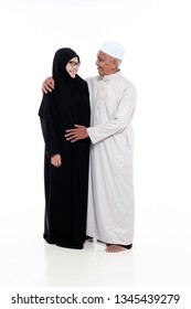 SUNGAI PETANI, MALAYSIA - 21 MARCH 2019:happy elderly couple portraits look at each other  isolated on white background.