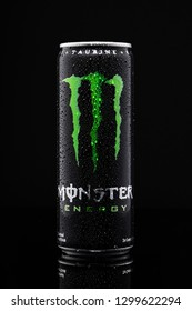 SUNGAI PETANI, MALAYSIA - JANUARY 29TH, 2019 :  A can of Monster Energy Drink isolated on black background. Introduced in 2002 Monster now has over 30 different drinks with high a caffeine content.