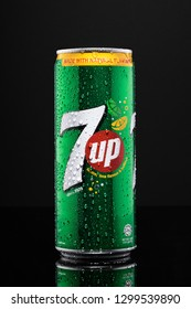 SUNGAI PETANI,MALAYSIA - JANUARY 29TH,2019 : 7 up can with water droplets isolated on black background.