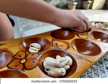 Sungka, a traditional Filipino pastime before gadgets, online games and  boardgames