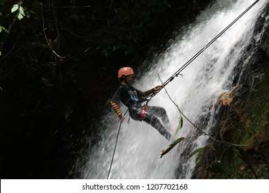 Sungkai, Perak, Malaysia 20 October : Young women abseil down at waterfall in Sungai Itik, Perak