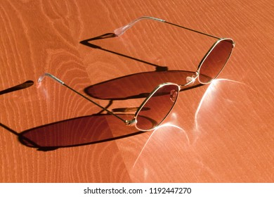 sunglases on wooden table