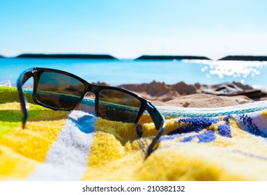 Sunglasses at the beach. Beach vacation holiday concept.