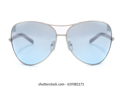 Sunglasses with blue glass in an iron frame isolated on white