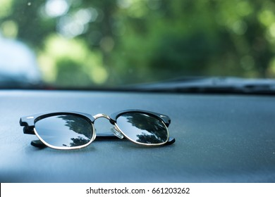 Sunglasses in a car