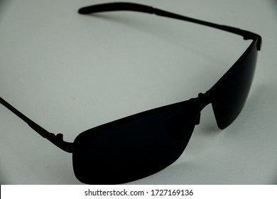Sunglasses close up on white backing