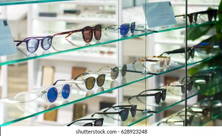 Sunglasses and Fashion Eyewear in a shop window optician.
