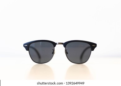 sunglasses front view on wooden table