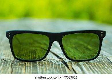 Sunglasses with green glass