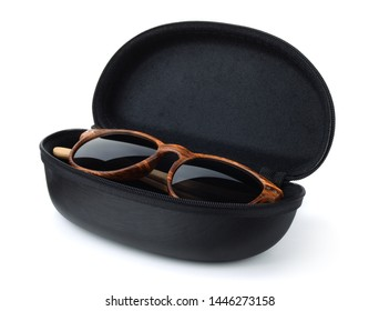 Sunglasses in hard black protective case isolated on white