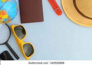 Sunglasses hat and accessories on Blue background with copy space.Summer Travel Holiday Concept