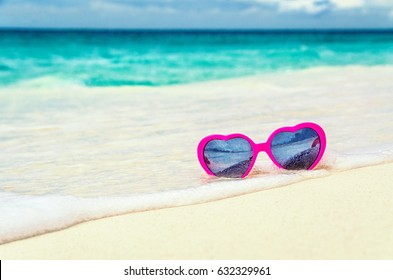 Sunglasses heart on the seashore