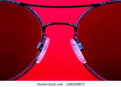 Sunglasses lenses isolated against a red background