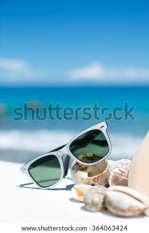 7b66f84770af sunglasses lying on tropical sand beach. party. white towel on desk and red  glasses