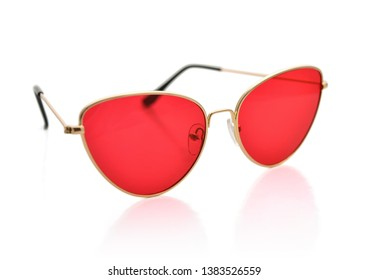 Sunglasses with metal frame, cat's eye shape, red lenses, isolated on white background with clipping path