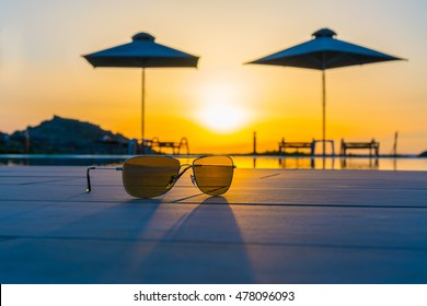 sunglasses near the swimming pool