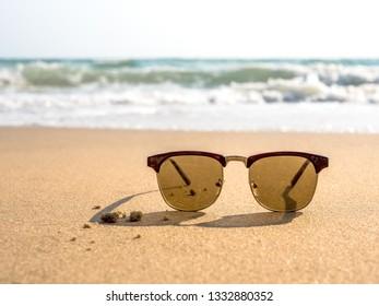 Sunglasses on the beach.