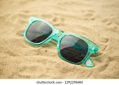 Sunglasses on beach background, summer