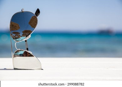 Sunglasses on the beach. Beautiful  sea view  wallpaper,  background