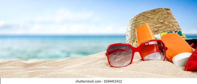 Sunglasses on beach and free space for your decoration.